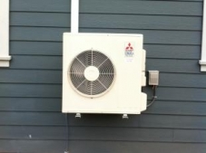 Heat pump outside a shop